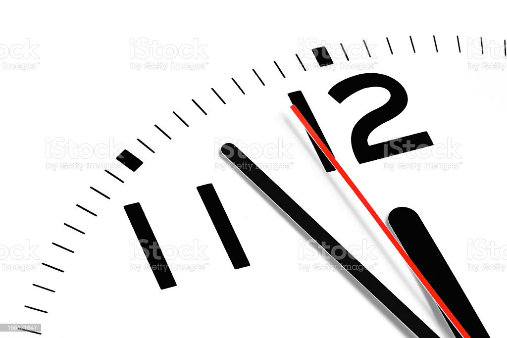Close up of the hands of a clock at 11:57 stock photo
