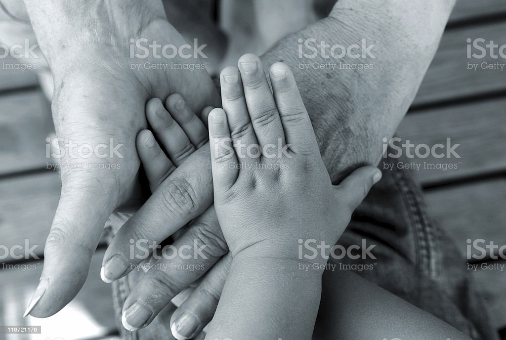 Close up of the hands of multiple generations royalty-free stock photo