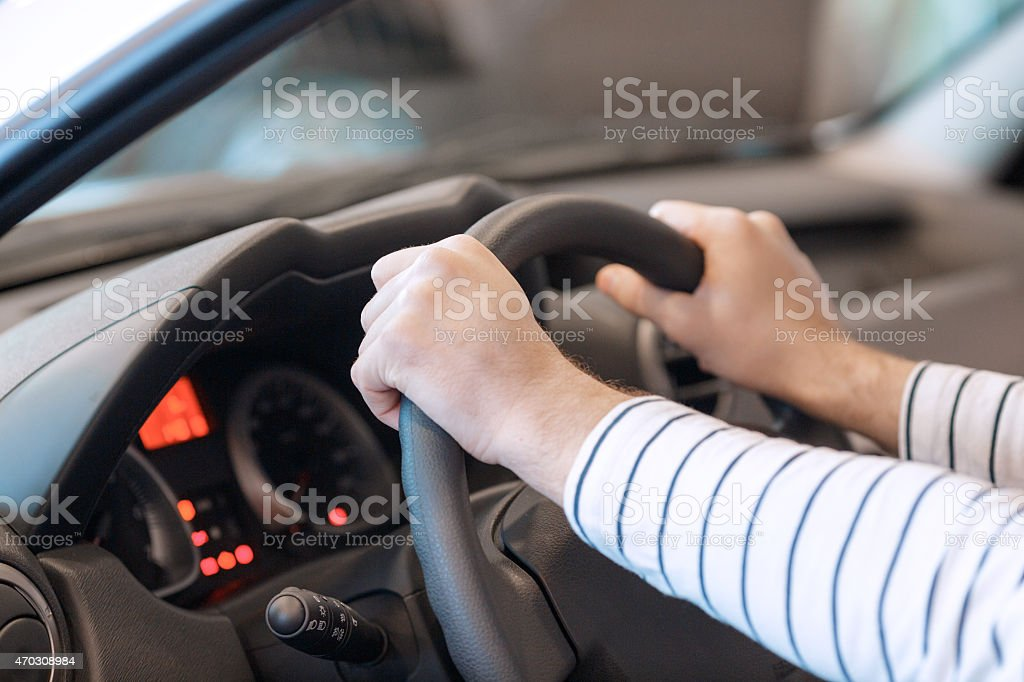 Close up of the hands on steering wheel stock photo