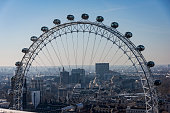Close up of the London Eye. It show a half of the ferris wheel, Behind them, the panorama of London.