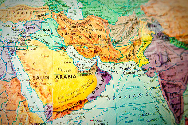 close up of the middle east on a world globe - saudi arabia map stock photos and pictures