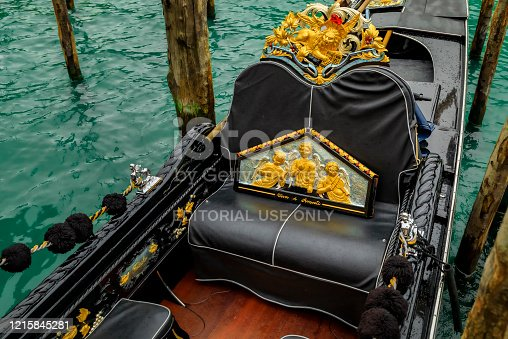 Venice, Italy - September 23, 2017: Close up of the ornamental detail of a traditional venetian gondola in a picturesque Venice Canal
