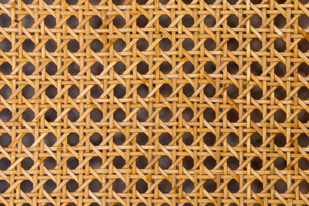 Close up of the pattern formed by open weave rattan cane Close up of the pattern formed by open weave rattan cane on a chair seat wicker stock pictures, royalty-free photos & images