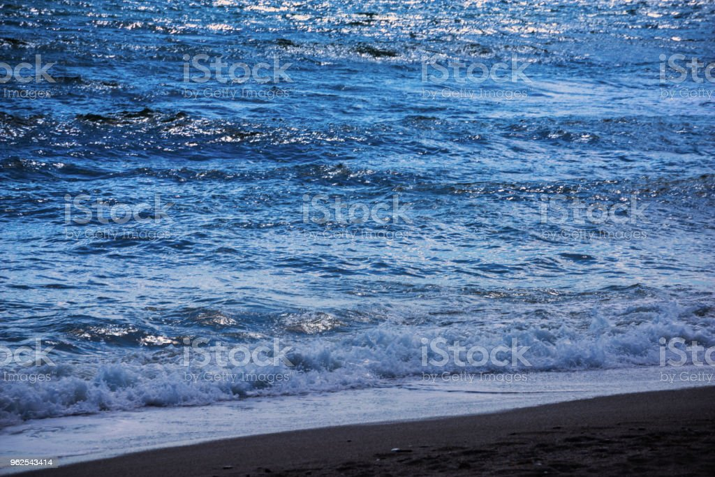 close up of the sea water affecting the sand on the beach, sea waves calmly flowing sand, relaxing view - Royalty-free Bay of Water Stock Photo