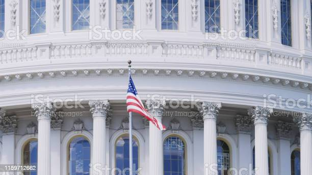Close up of the stars and stripes flag on the capitol building dc picture id1159712662?b=1&k=6&m=1159712662&s=612x612&h=indoarin5ffmzq3tk6jomonzgjvnptrfr9yhi4is5b0=