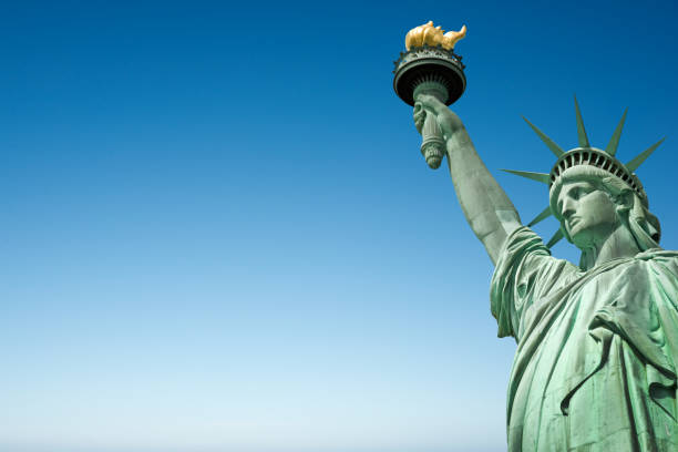 Close up of the Statue of Liberty in New York, USA. Blue sky background with copy space Close up of the Statue of Liberty in New York, USA. Blue sky background with copy space liberty island stock pictures, royalty-free photos & images
