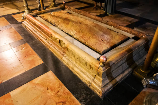 Close up of the Stone of Unction, the spot, where Jesus' body was prepared for burial by Joseph of Arimathea. The Church of the Holy Sepulchre in Jerusalem, Israel, October 23, 2018 stock photo