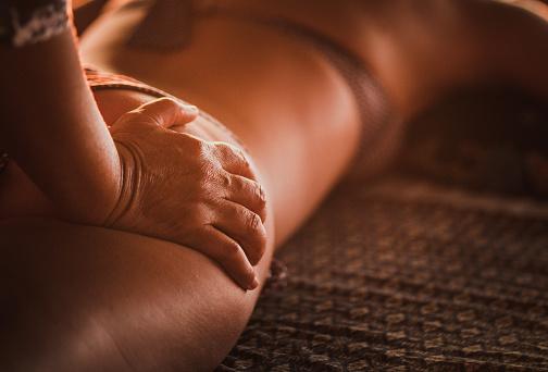 istock Close up of therapist giving shiatsu massage to her customer. 1126190619