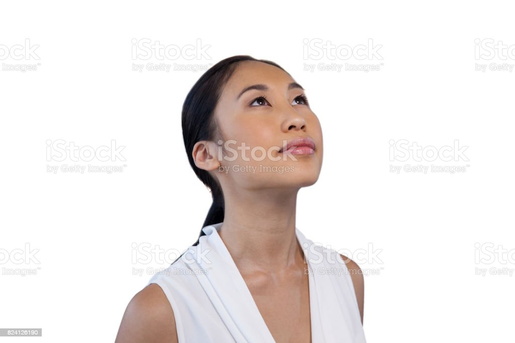 Close up of thoughtful businesswoman looking up stock photo