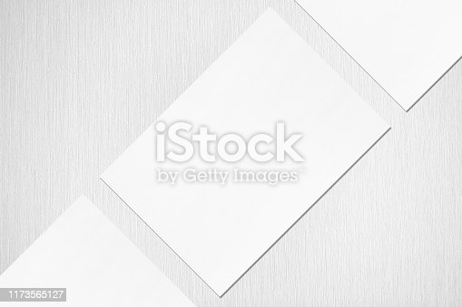 1173565159 istock photo Close up of three empty white rectangle poster or card mockups lying diagonally 1173565127