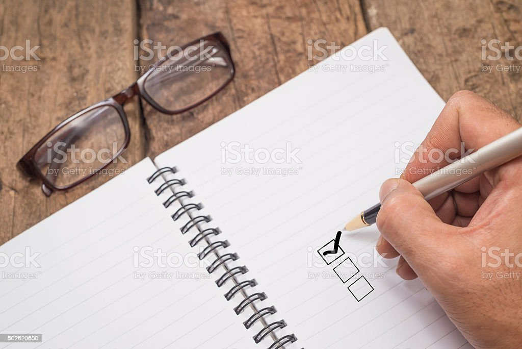 close up of ticked check list box. stock photo