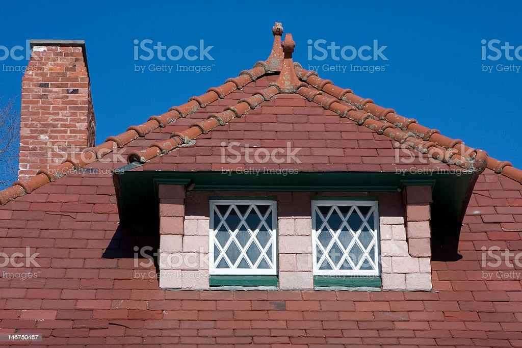 Close up of tile roof with dormer and chimney stock photo