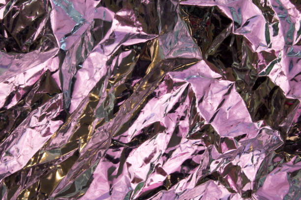 Close Up of Tin Metal Foil Holographic Abstract Background stock photo