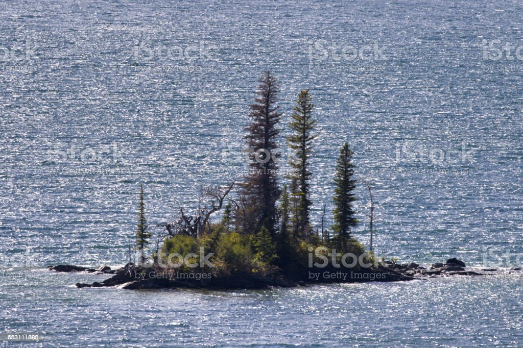 Close up of tiny Wild Goose Island in Glacier National Park stock photo