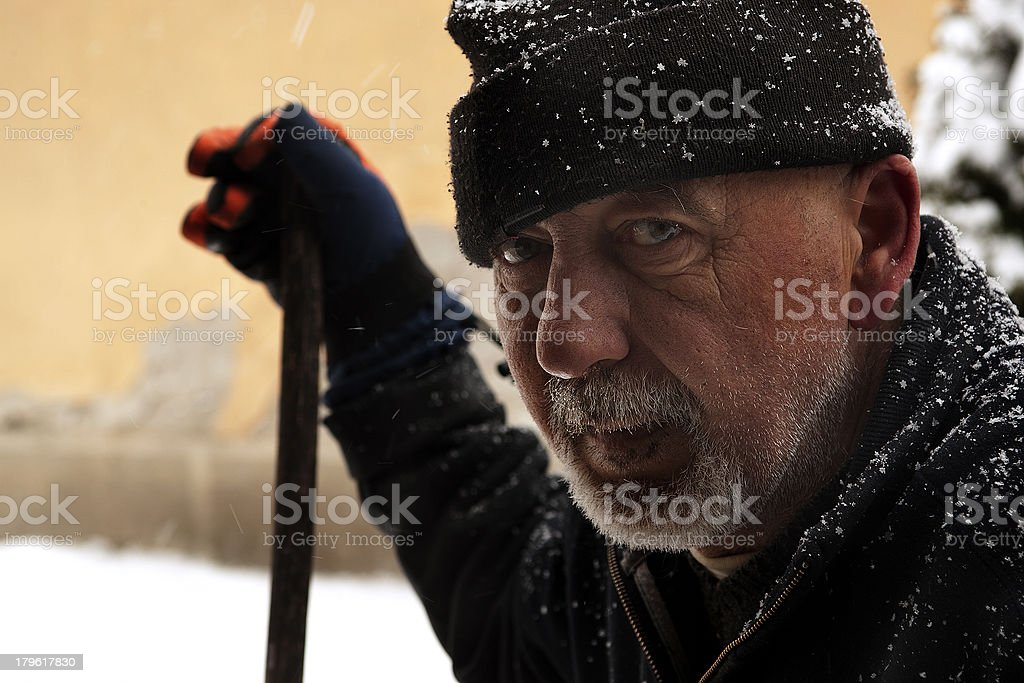 Close up of tired snow shoveling man stock photo
