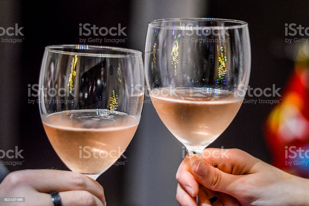 close up of toasting friends hands stock photo