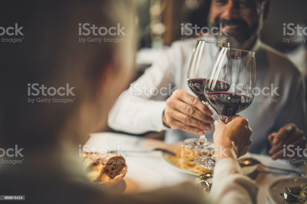 Close up of toasting with wine in a restaurant! stock photo
