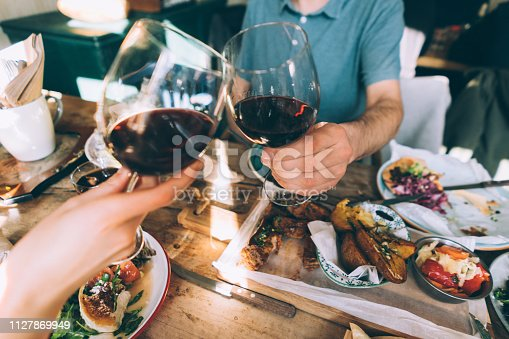 Close up of toasting with wine in a restaurant