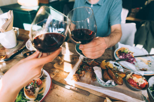 close up of toasting with wine - foodie stock photos and pictures