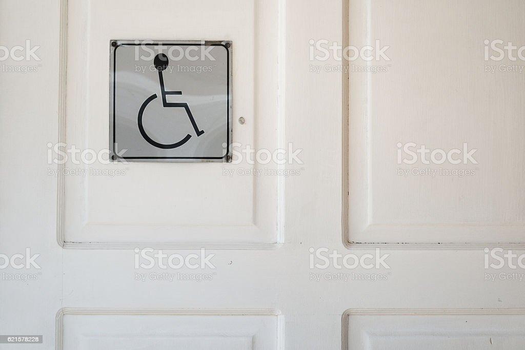 close up of toilet door with disable sign photo libre de droits