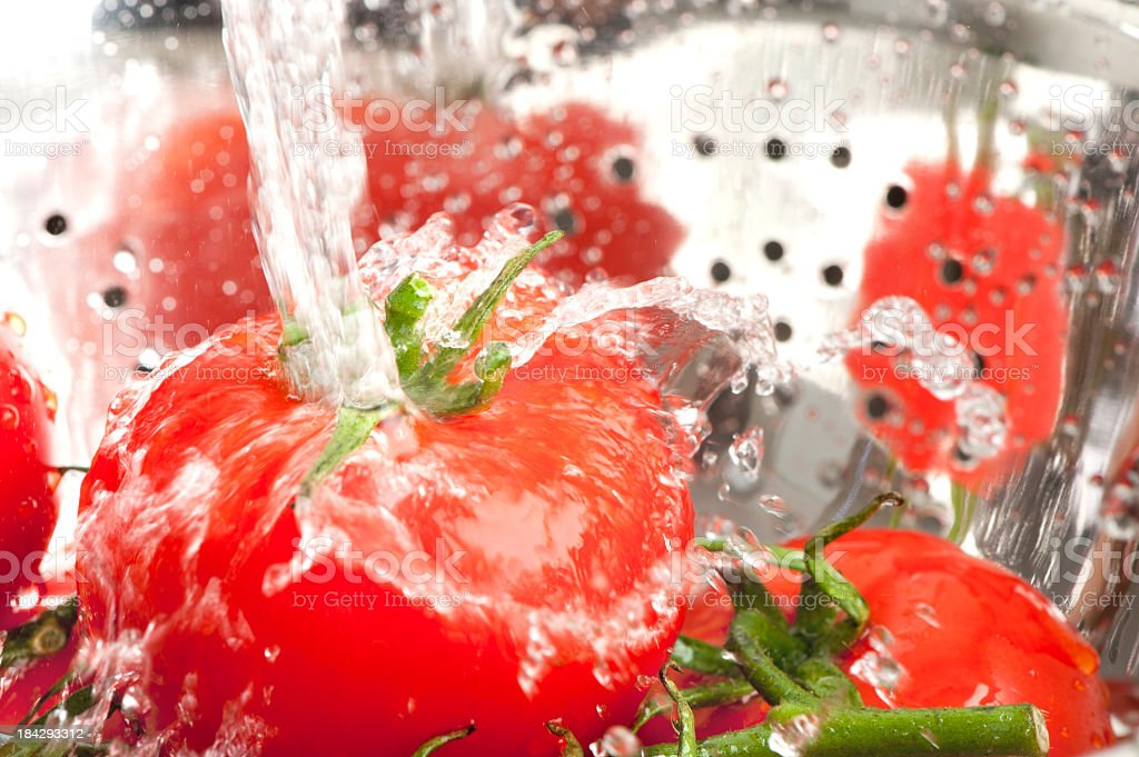 Close up of tomatoes being washed stock photo