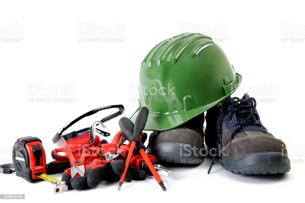 Close up of tools and work wear for electrical installations, isolated on white background stock photo