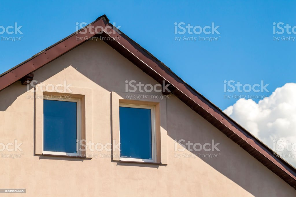 Close up of top windows under roof in house stock photo