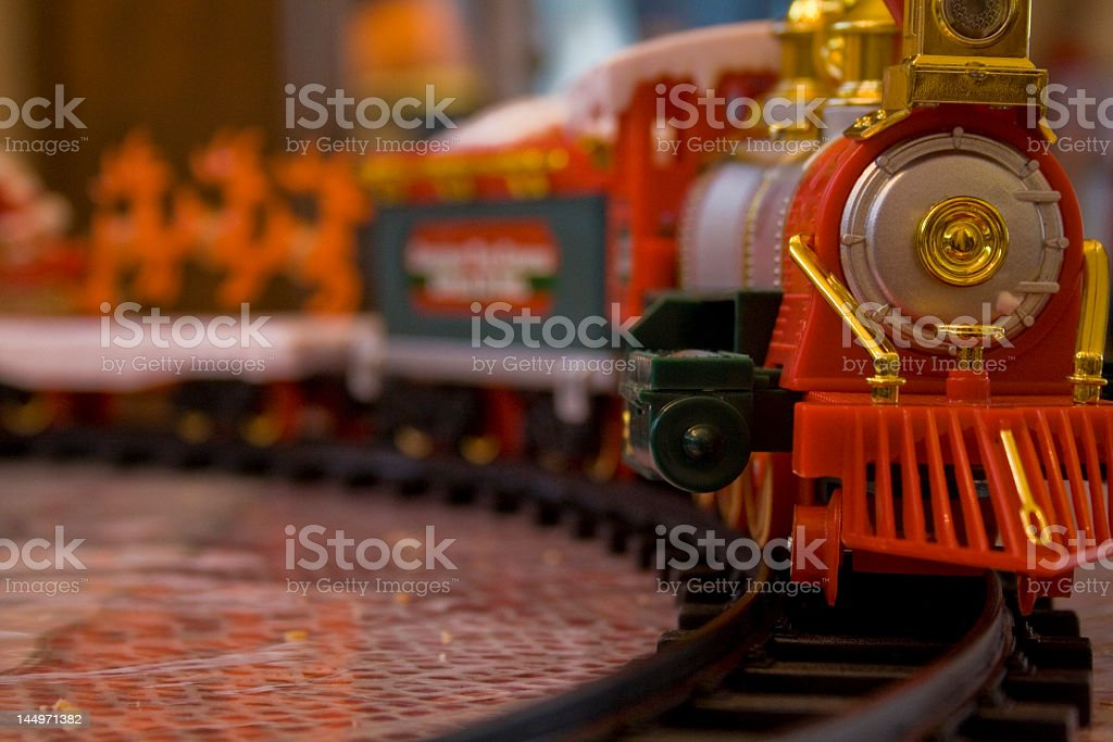 Close up of toy train on train tracks stock photo