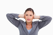istock Close up of tradeswoman covering her ears 824942718