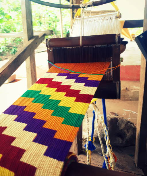 close up of traditional kente cloth weaving around kumasi, ghana - kente cloth stock photos and pictures