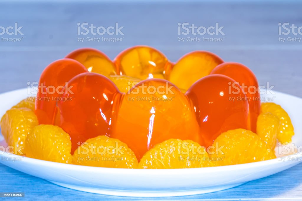 Close Up of Translucent Mouthwatering Orange Jelly Mould stock photo