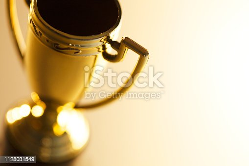 Close-up of a gold trophy photographed with a very shallow depth of field.