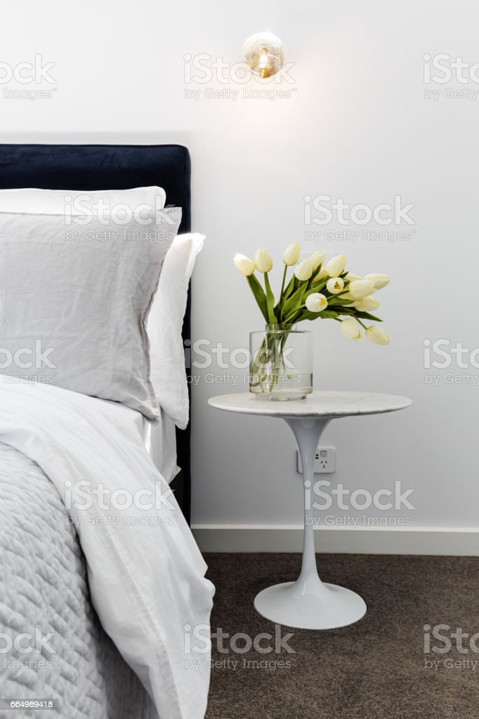 Close up of tulips on a marble bedside table stock photo