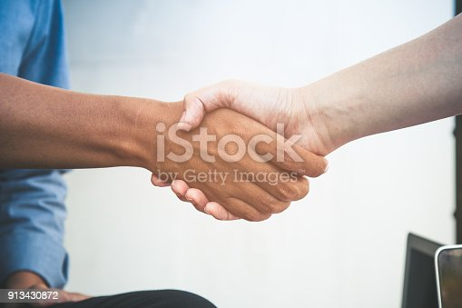 istock Close up of two business man do hand shaking after acceptation the agreement 913430872