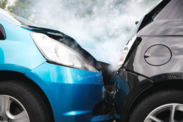 Close Up Of Two Cars Damaged In Road Traffic Accident Close Up Of Two Cars Damaged In Road Traffic Accident crash stock pictures, royalty-free photos & images