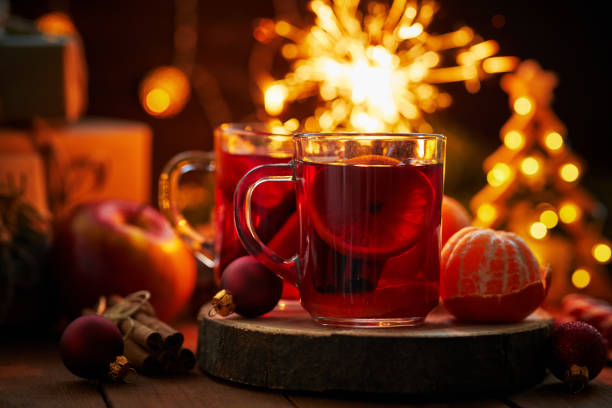 Close up of two glasses of hot tea on Christmas table stock photo