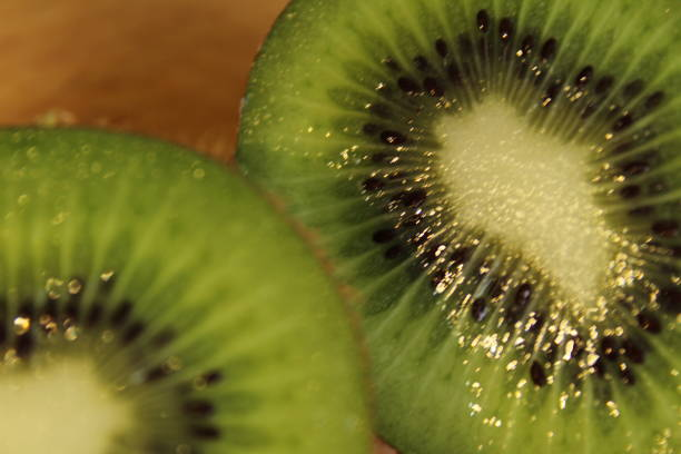 Close up of two kiwis cut in half stock photo