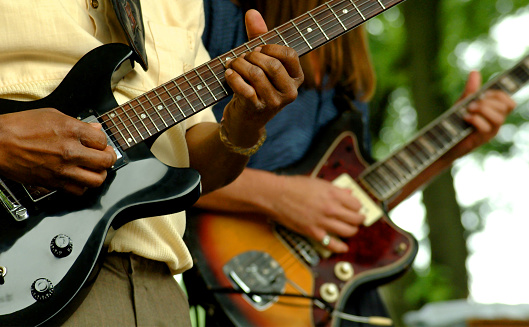 Close up shot of two guitar players shot at the Chicago Bluesfestival. Only shows guitars and hands.