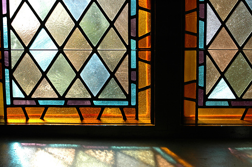A close up of two stained glass windows