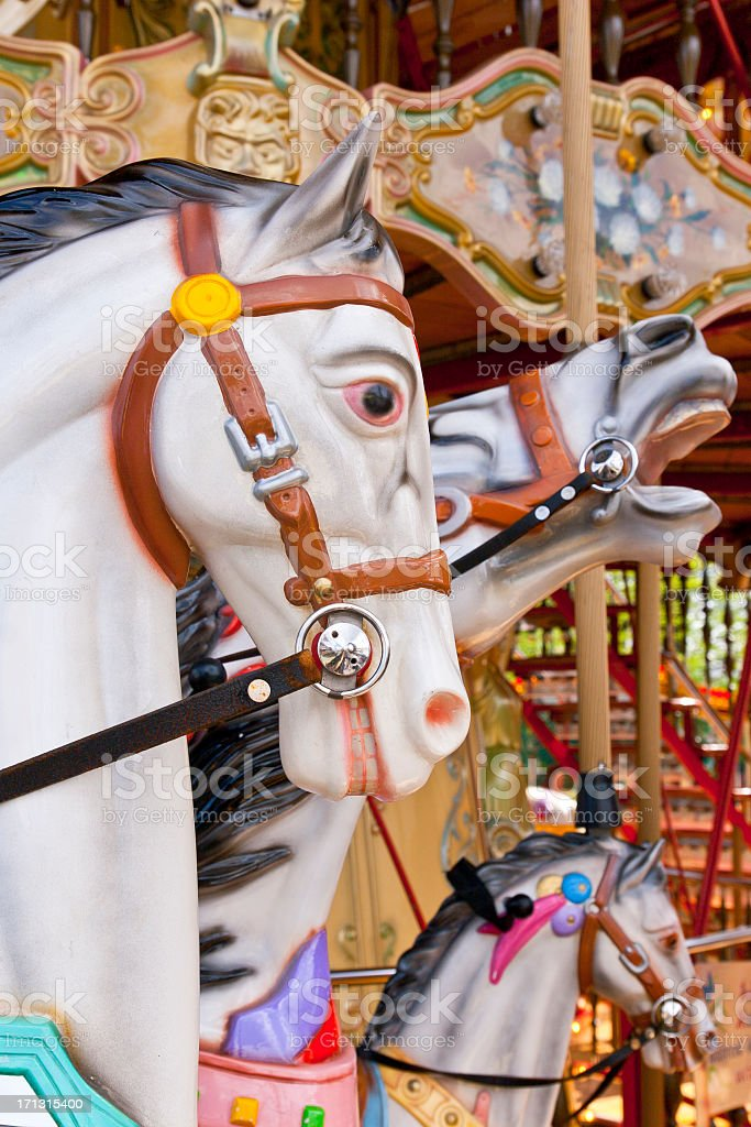 Close up of two white carousel horses next to each other stock photo