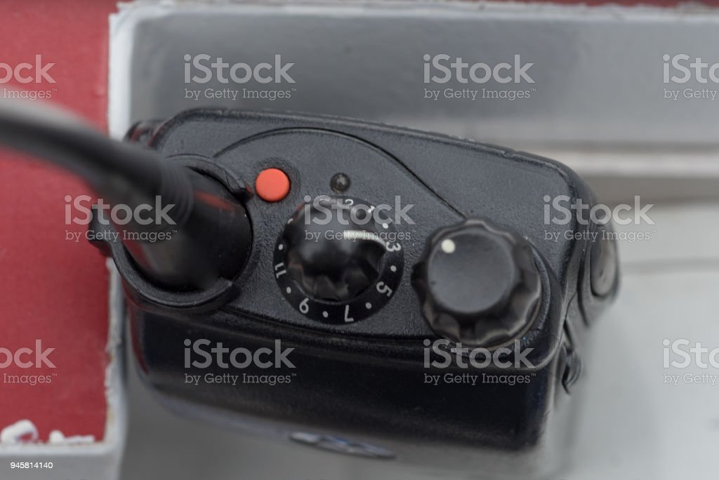 close up of UHF VHF walkie talkies and antenna with controls set to 3 stock photo