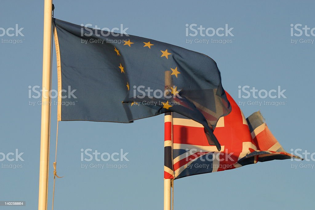 Close up of UK and EU flags waving in the wind royalty-free stock photo