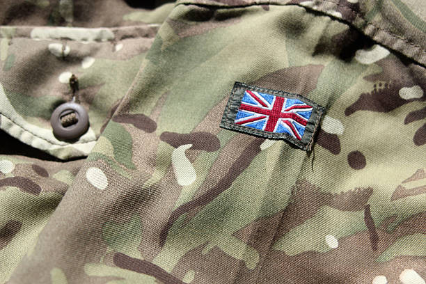 close up of uk military uniform with union flag - uk military stock photos and pictures