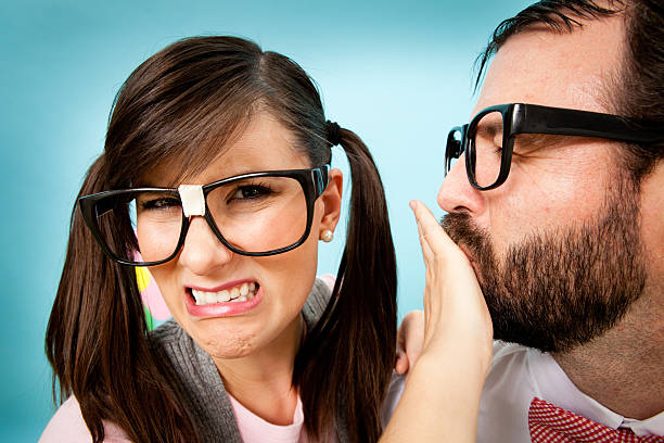 Close Up of Unhappy Nerd Girl With Nerdy Man stock photo