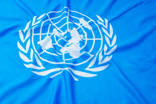 Fujian, China - April 6, 2017: Close up of United Nations flag.  The United Nations (UN) is an international organization whose stated aims are facilitating cooperation in international law, international security, economic development, social progress, human rights, and achievement of world peace.