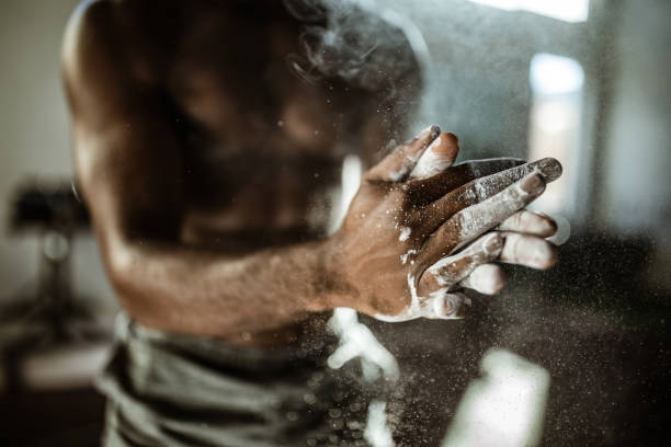 Close up of unrecognizable athlete preparing his hands with powder. stock photo