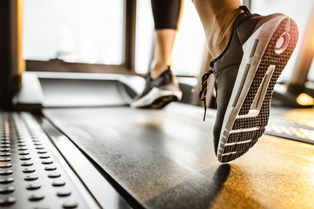 close up of unrecognizable athlete running on a treadmill in a gym. - human limb stock pictures, royalty-free photos & images