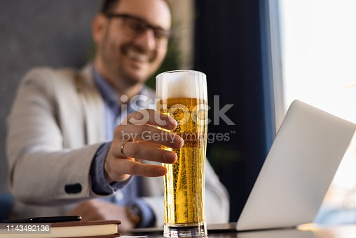 istock Close up of unrecognizable man drinking  beer. 1143492136