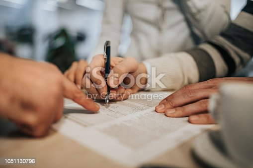 1072035844istockphoto Close up of unrecognizable man signing a contract. 1051130796