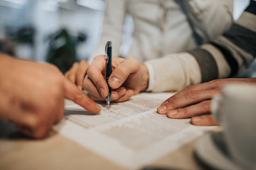 1072035844 istock photo Close up of unrecognizable man signing a contract. 1051130796